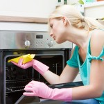 bigstock Young Woman Cleaning Oven In T 47210212 | Stay at Home Mum.com.au