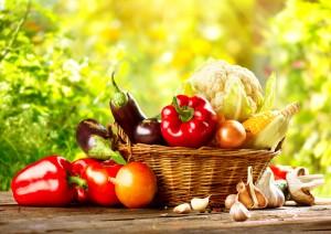 Vegetables. Fresh Bio Vegetable in a Basket. Over green blurred