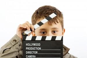 bigstock-Boy-With-Movie-Clapper-Board-10026356