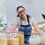 bigstock Storing Food In Kitchen Woman 414874157 | Stay at Home Mum.com.au