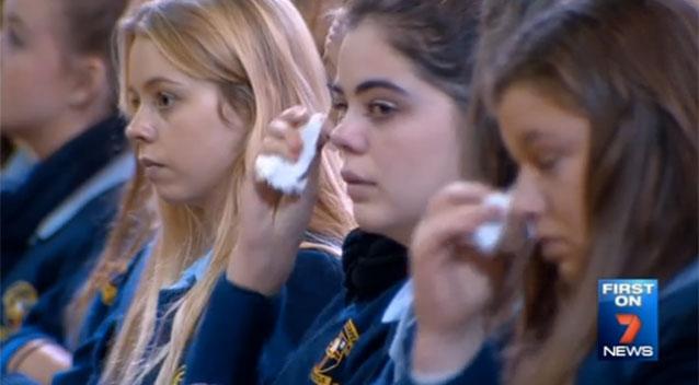 Students cry listening to Michelle Davis talk.