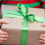 child holding christmas present e1449129712537 | Stay at Home Mum.com.au