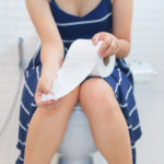 bigstock Woman Sitting On Toilet With T 237445087 | Stay at Home Mum.com.au