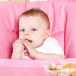bigstock Cute Baby Eating Biscuit 82006847 | Stay at Home Mum.com.au
