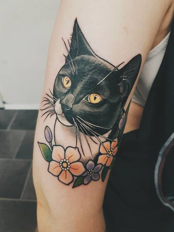 6e67317399f63 33 Mesmerising Cat Tattoos So Your Little Friend Can Live Forever