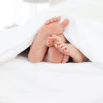 bigstock Couple s feet in the bed 13805534 | Stay at Home Mum.com.au