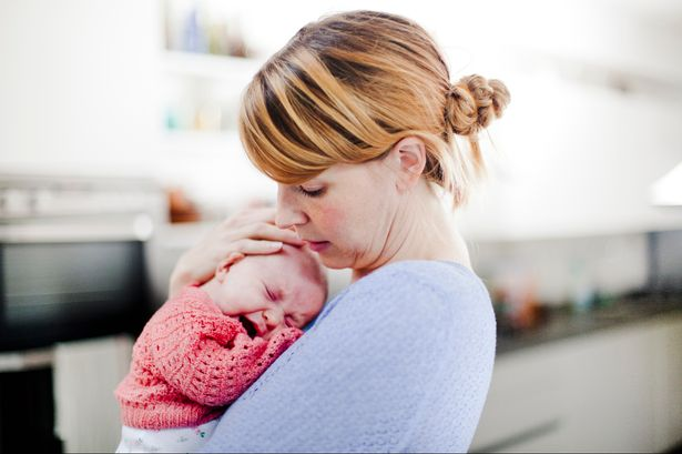 Mother holding crying daughter | Stay at Home Mum.com.au