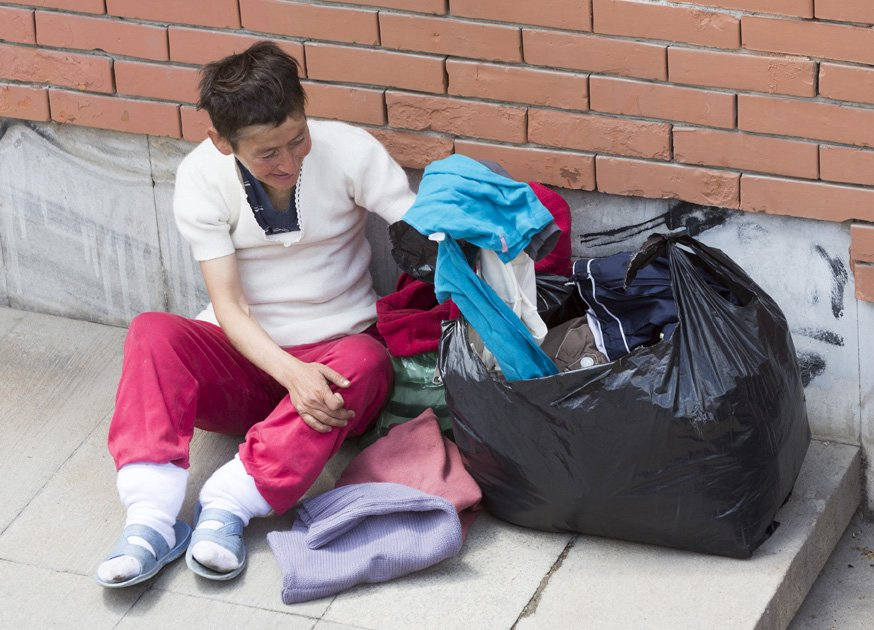homeless woman with big bag of clothing | Stay at Home Mum.com.au