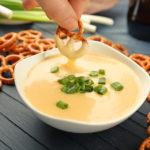 bigstock Female hand dipping pretzel in 178390420 | Stay at Home Mum.com.au