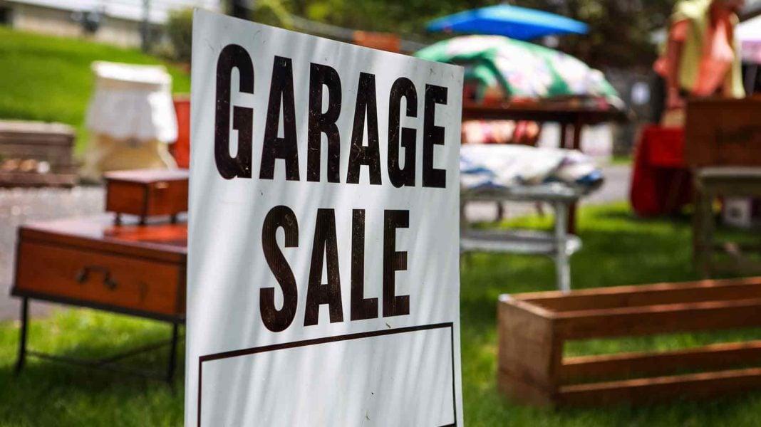 garage sale sign on shady lawn   Stay at Home Mum.com.au