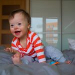 baby boy on bed | Stay at Home Mum.com.au